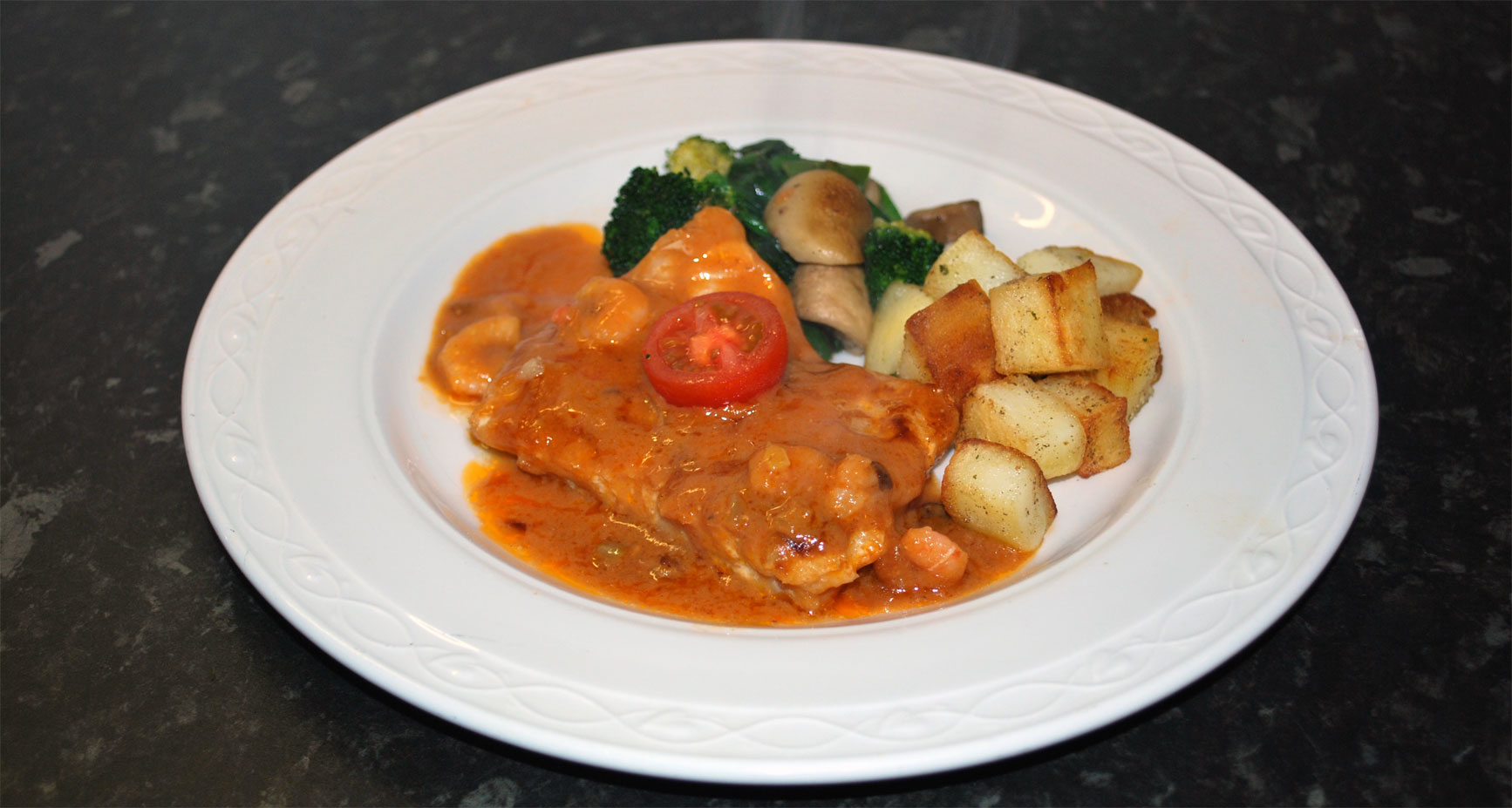 Fillet of Cod  in Seafood Sauce with Prawns