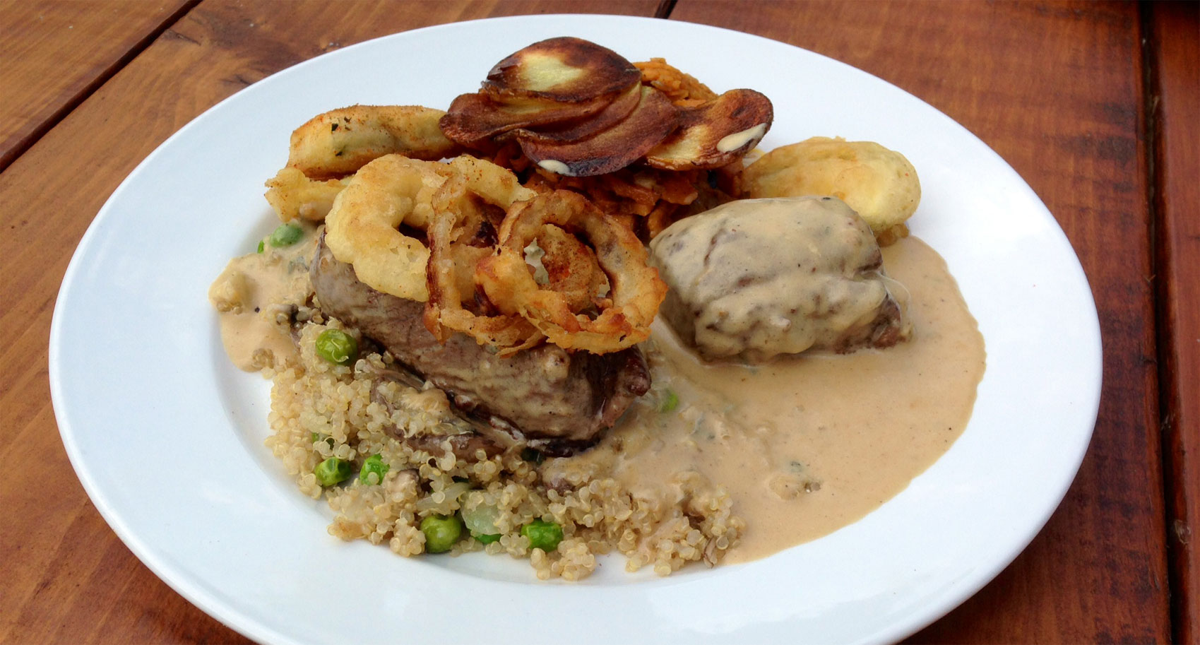 Loin of Venison in Smitane Sauce with Onion Rings